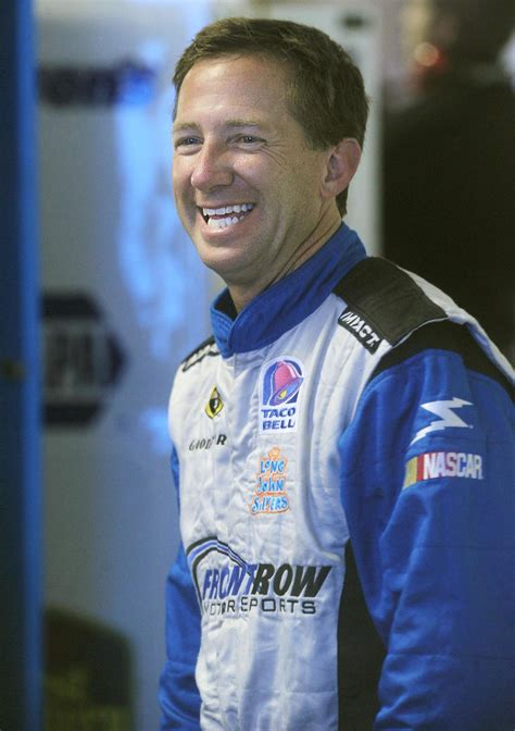 John Andretti receiving prayers and support from everyone