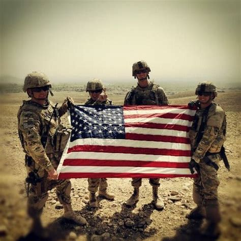 Troops showing the American flag